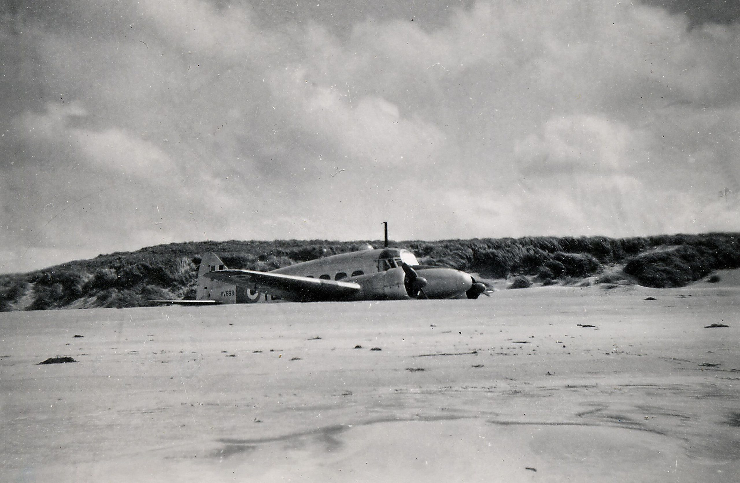 An Avro Anson T20 Trainer lies on the sandy beach at Balnakeil after crash landing in 1952